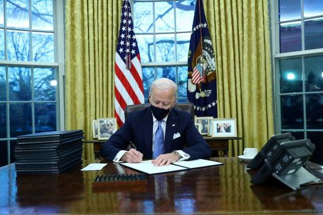 Jod Biden's First day in Office targets Trump policies on climate, coronavirus, immigration