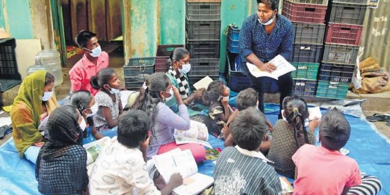 Chennai Homeless Man offers tuition to Street kids